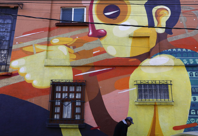 """A mural decorates a building on Tepeji Street where Mexican film director Alfonso Cuaron grew up in the 1970s in the Roma Sur neighborhood of Mexico City, Wednesday, December 19, 2018. News of Alfonso Cuaron's """"Roma"""" being nominated for 10 Academy Awards had residents of the director's childhood Mexico City neighborhood joyfully mining their own memories and anticipating showing their children the film someday. (Photo by Rebecca Blackwell/AP Photo)"""