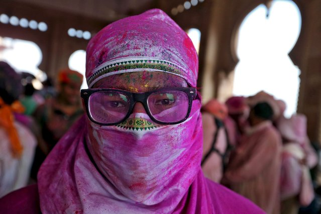 A Hindu devotee takes part in the religious festival of Holi, also known as the festival of colours, in the town of Barsana in the Uttar Pradesh region of India, March 16, 2016. (Photo by Cathal McNaughton/Reuters)