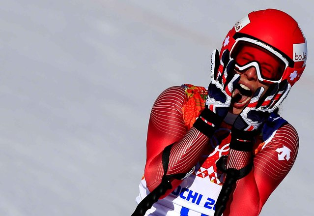Switzerland's Dominique Gisin reacts after finishing the Women's Alpine Skiing Downhill at the Rosa Khutor Alpine Center during the Sochi Winter Olympics on February 12, 2014. (Photo by Alexander Klein/AFP Photo)