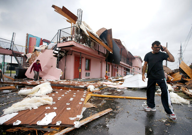 A man walks through the debris of once was a motel on Chef Menture Ave after a tornado touched down on February 7, 2017 in New Orleans, Louisiana. (Photo by Sean Gardner/Getty Images)