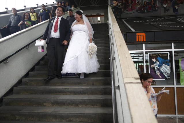 A newlywed couple enters a subway station after a mass wedding ceremony in which 2,016 couples participated, at Zocalo square in Mexico City, Mexico, March 19, 2016. (Photo by Edgard Garrido/Reuters)