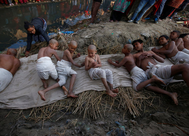 Devotees offer prayers by rolling near the bank of the Hanumante River during the final day of the month-long Swasthani Brata Katha festival in Bhaktapur, Nepal February 10, 2017. (Photo by Navesh Chitrakar/Reuters)