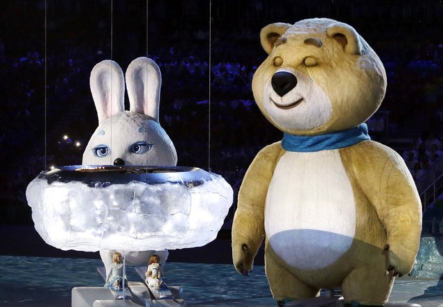 One of the Sochi 2014 mascots sheds a tear after extinguishing the Olympic flame. (Photo by Mark Baker/Associated Press)