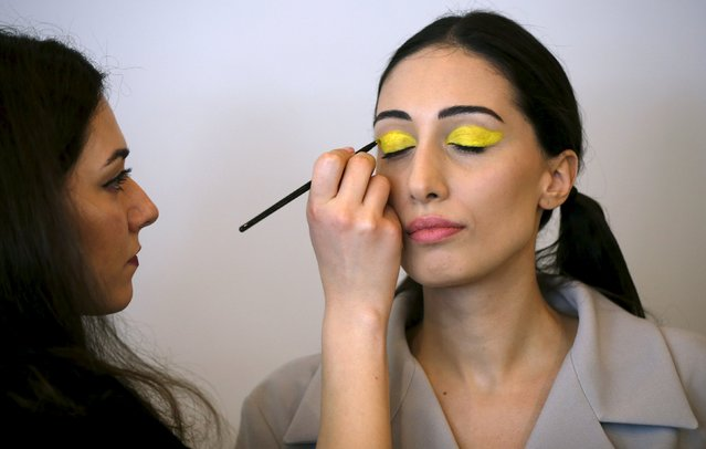 A model gets her makeup done backstage during the Mercedes-Benz Fashion Days in Tbilisi, Georgia, May 2, 2015. (Photo by David Mdzinarishvili/Reuters)