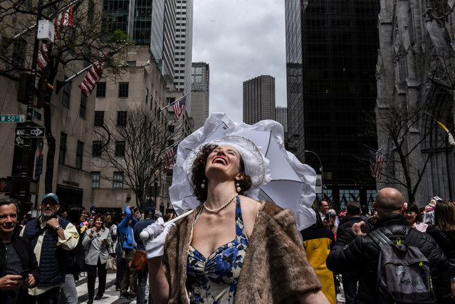 A woman reacts to the sun coming out of the clouds during the annual Easter Parade and Bonnet Festival on Fifth Avenue in New York City, New York, U.S. April 21, 2019. (Photo by Stephanie Keith/Reuters)