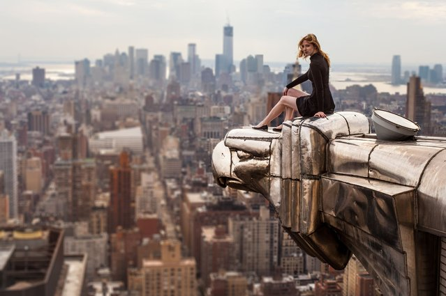 Lucinda Grange perches on the eagle's head on the corner of New York's iconic Chrysler Building in Manhattan, New York City. (Photo by Lucinda Grange/Barcroft Media USA)