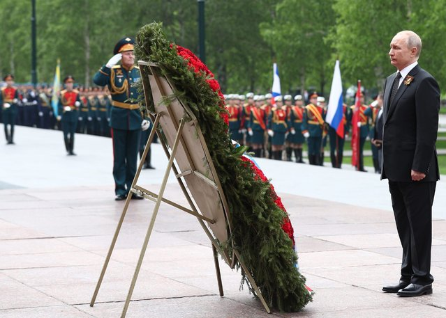 Russia's President Vladimir Putin lays flowers at the Tomb of the Unknown Soldier by the Kremlin Wall during celebrations marking the victory of the Soviet Red Army over Nazi Germany in the Great Patriotic War of 1941-45, the Eastern Front of the Second World War. Mikhail Tereshchenko/TASS (Photo by Mikhail Tereshchenko/TASS via Getty Images)