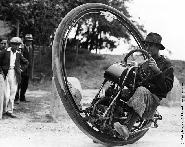 Swiss engineer Gerder at Arles, France on his way to Spain in his Motorwheel, a motorcycle with a wheel which runs on a rail placed inside a solid rubber tyre