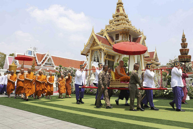 In this photo released by King Power, Thai Buddhist monks walk during a cremation ceremony sponsored by the Thai King Maha Vajiralongkorn at the Debsirindrawas Ratchaworawiharn Temple in Bangkok, Thailand, Thursday, March 21, 2019. Vichai died last year when his helicopter crashed in a parking lot next to the English Premier League club's stadium. (Photo by King Power via AP Photo)