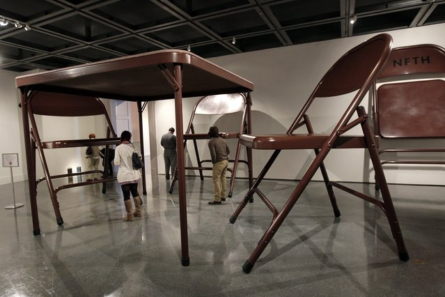 Giant folding tables and chairs are part of the untitled installation by artist Robert Therrien on display at the New Orleans Museum of Art,  in New Orleans, Wednesday, November 14, 2012. (Photo by Gerald Herbert/AP Photo)