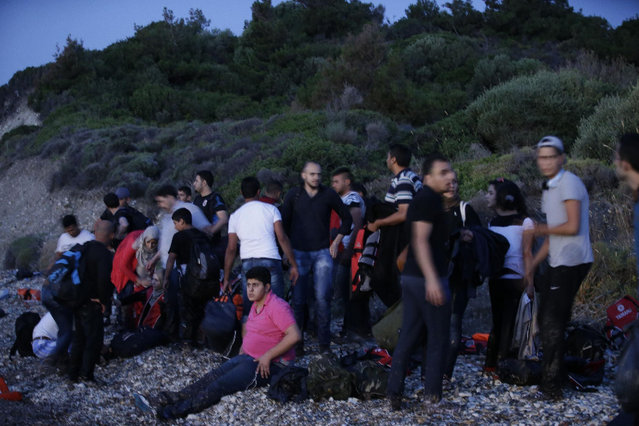 Syrian migrants arrive from Turkish coasts at a beach in Mytilene, on the northeastern Greek island of Lesvos, early Tuesday, June 16, 2015. Lesvos has been bearing the brunt of a huge influx of migrants from the Middle East, Asia and Africa crossing from the Turkish coast to nearby Greek islands. More than 50,000 migrants have arrived in Greece already this year, compared to 6,500 in the first five months of last year. (AP Photo/Thanassis Stavrakis)