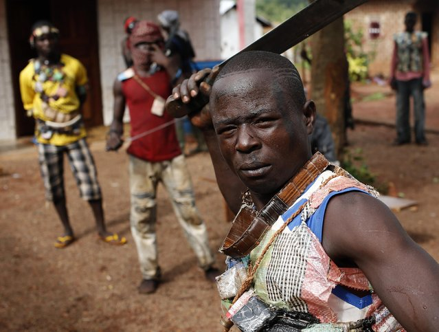 A member of the anti-balaka, a Christian militia, poses with his machete in village of Zawa April 8, 2014. (Photo by Goran Tomasevic/Reuters)