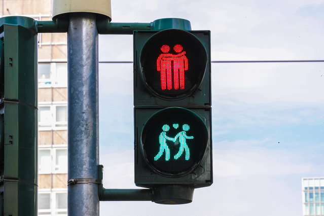 Traffic lights feature illustrations of a homosexual couple in downtown Frankfurt Main, Germany, 18 July 2019. An annual gay pride parade will take place on 20 July 2019 in Frankfurt to commemorate Christopher Street Day (CSD). The event commemorates the riots that erupted following a police raid in 1969 at a gay bar on Christopher Street in Greenwich Village, New York City. (Photo by Armando Babani/EPA/EFE)