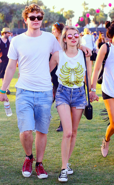 Emma Roberts held onto her fiancé Evan Peters while walking the fields of the Coachella Music Festival in Indio, CA. (Photo by Sharpshooter Images/Splash News)