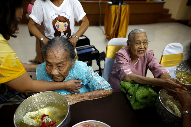 Somjit Phuthasiri (R), 90, attends Songkran festival at Wellness Nursing Home Center in Ayutthaya, Thailand, April 9, 2016. (Photo by Athit Perawongmetha/Reuters)