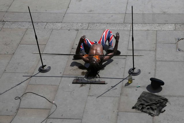 A busker performs at Trafalgar Square in London, Britain May 6, 2016. (Photo by Stefan Wermuth/Reuters)