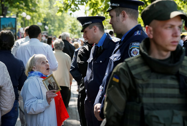 A woman carries a picture of World War Two participant as she takes part in the Immortal Regiment march during the Victory Day celebrations, marking the 71st anniversary of the victory over Nazi Germany in World War Two, in central Kiev, Ukraine, May 9, 2016. (Photo by Gleb Garanich/Reuters)