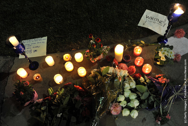 Flower tributes are left at the Beverly Hilton Hotel in the early hours