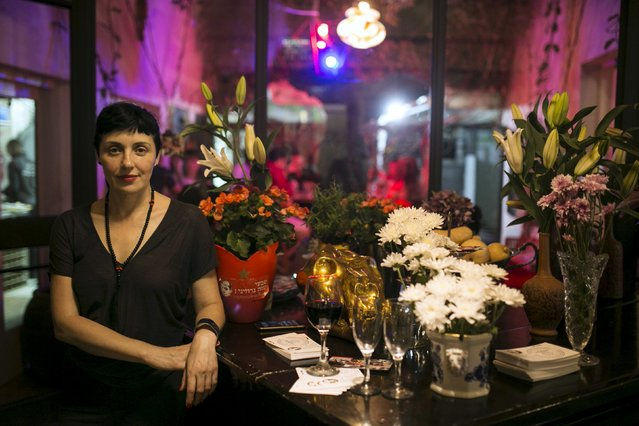 Nana Shrier, owner of Georgian restaurant Nanuchka, poses for a photo in her restaurant in Tel Aviv, Israel July 15, 2015. Shrier shocked Israel's culinary world when she removed all animal-based products from the menu. Nanuchka is part of a growing trend that has transformed Israel's financial center into a haven for meatless cuisine. (Photo by Baz Ratner/Reuters)