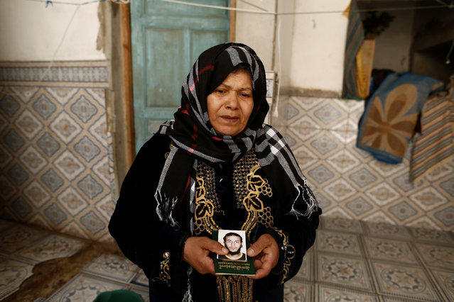 Fethiya Charni holds a photograph and the passport of her son Tarak Slimi, who is suspected to have joined  Islamic State in Libya, at her house in El Kef, Tunisia April 14, 2016. (Photo by Zohra Bensemra/Reuters)