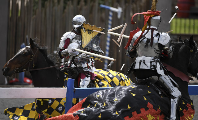 """England's Andrew Deane (L) jousts with Australia's Phil Leitch (R) during the inaugural """"Ashes"""" jousting tournament between Australia and England at the Kryal Castle in Leigh Creek, some 100 kms west of Melbourne, on November 3, 2019. Australia and England took their storied sports rivalry to another level, and another century, this weekend as the two nations faced off in a jousting tournament, won by the Australian side on November 3. (Photo by William West/AFP Photo)"""