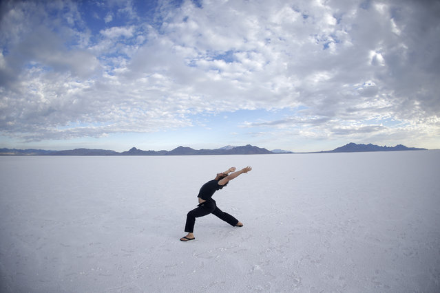 In this Wednesday, July 22, 2015 photo, Sam Evers of Houston performs his yoga on the Bonneville Salt Flats in Utah. (Photo by Rick Bowmer/AP Photo)