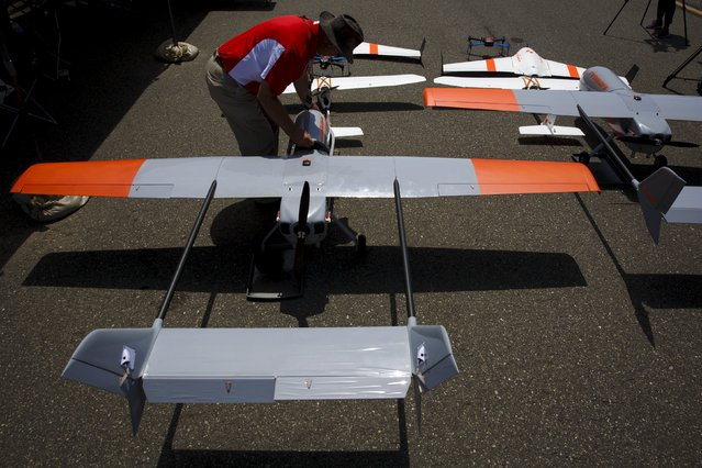"""The FireFlight UAS TwinHawk is readied for flight during """"Black Dart"""", a live-fly, live fire demonstration of 55 unmanned aerial vehicles, or drones, at Naval Base Ventura County Sea Range, Point Mugu, near Oxnard, California July 31, 2015. (Photo by Patrick T. Fallon/Reuters)"""