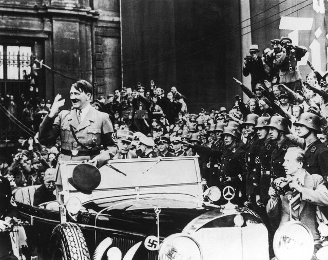 Nazi leader Adolf Hitler (1889 - 1945) on his way to a  May Day youth rally at the Lustgarten in Berlin, circa 1938