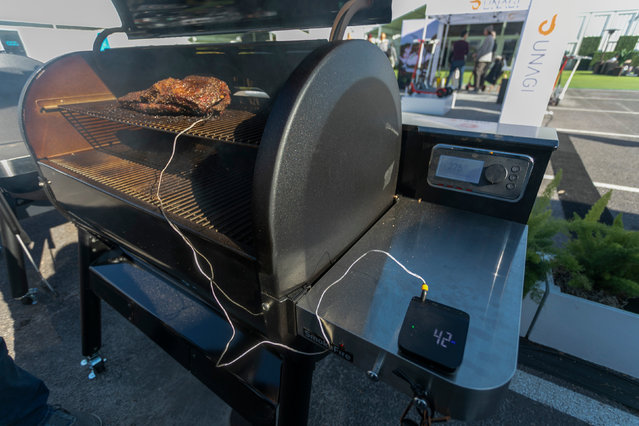 The new Weber Connect smart grilling hub, consisting of a meat thermometer, wireless transmitter and app, is displayed at the 2020 Consumer Electronics Show (CES) in Las Vegas, Nevada on January 9, 2020. CES is one of the largest tech shows on the planet, showcasing more than 4,500 exhibiting companies representing the entire consumer technology ecosystem. (Photo by David McNew/AFP Photo)