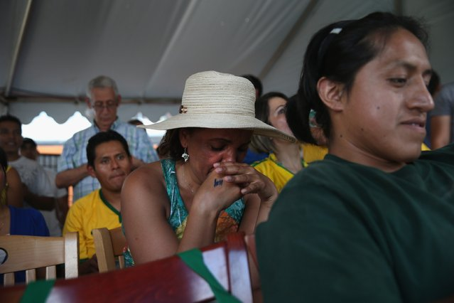 Brazilian fans watch during the semifinal World Cup game against Germany on July 8, 2014 in Port Chester, United States. Fans, mostly for Brazil, gathered at the Copacabana Restaurant in Westchester County to watch on outdoor TV screens. (Photo by John Moore/Getty Images)