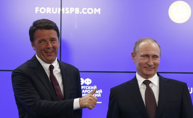 Russian President Vladimir Putin and Italian Prime Minister Matteo Renzi attend a signing ceremony after their meeting at the St. Petersburg International Economic Forum 2016 (SPIEF 2016) in St. Petersburg, Russia, June 17, 2016. (Photo by Grigory Dukor/Reuters)