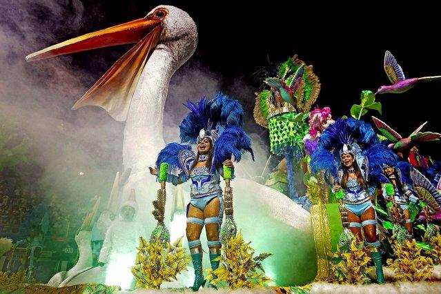 Dancers from the Dragoes da Real samba school perform in Sao Paulo