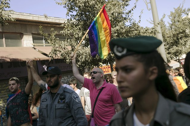 Israeli police and border police secure members of the gay community as they march against violence and for equal rights in Jerusalem August 14, 2015. (Photo by Baz Ratner/Reuters)