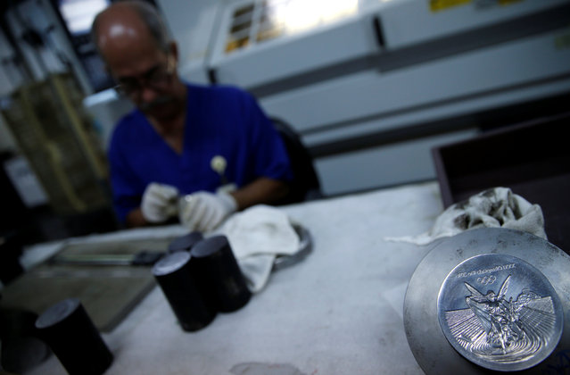 A worker from the Casa da Moeda do Brasil (Brazilian Mint) prepare Rio 2016 Olympic medals in Rio de Janeiro, Brazil, June 28, 2016. (Photo by Sergio Moraes/Reuters)
