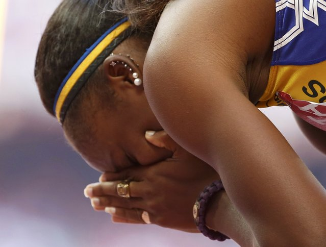 Kierre Beckles of Barbados reacts after competing in the women's 100 metres hurdles heats during the 15th IAAF World Championships at the National Stadium in Beijing, China August 27, 2015. (Photo by Lucy Nicholson/Reuters)
