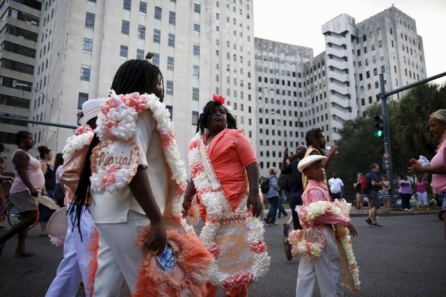 The Original Big 7 Junior Steppers parade past Charity Hospital, closed and vacant since Hurricane Katrina, in a second line parade to mark the tenth anniversary of the storm in New Orleans, Louisiana August 29, 2015. (Photo by Edmund D. Fountain/Reuters)