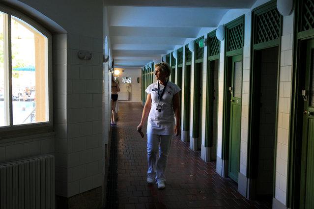 Mariann Eva, a manager at the Lukacs Bath, walks along a corridor in Budapest, Hungary, June 23, 2016. (Photo by Bernadett Szabo/Reuters)