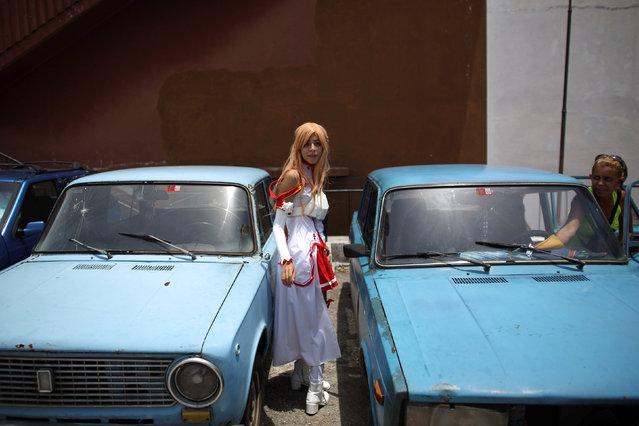 Massiel Alvarez, 18, enters a car at the end  of the Cuban Otaku festival in Havana, Cuba, July 24, 2016. (Photo by Alexandre Meneghini/Reuters)