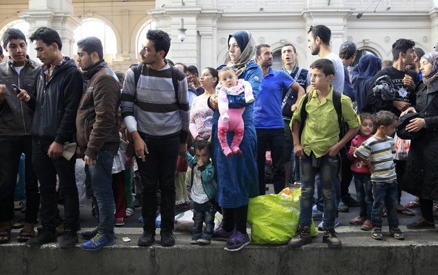 Migrants wait on a platform for a train at the Keleti train station in Budapest, Hungary, September 3, 2015 as Hungarian police withdrew from the gates after two days of blocking their entry. (Photo by Bernadett Szabo/Reuters)