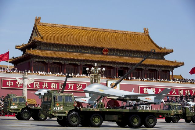 Military vehicles carrying Wing Loong, a Chinese-made medium altitude long endurance unmanned aerial vehicle, travel past Tiananmen Gate during a military parade to commemorate the 70th anniversary of the end of World War II in Beijing Thursday September 3, 2015. (Photo by Andy Wong/Reuters)