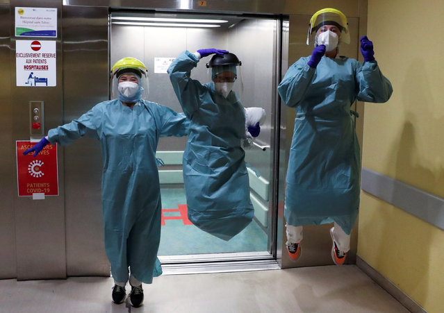 Medical personnel jump in the COVID-19 unit at the CHR Centre Hospitalier Regional de la Citadelle Hospital, during the coronavirus disease (COVID-19) outbreak, in Liege, Belgium, April 22, 2020. (Photo by Yves Herman/Reuters)