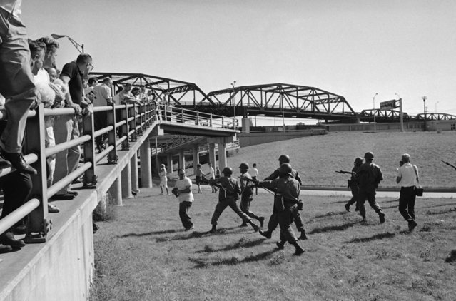 Bayonet of Illinois National Guardsmen drive civil rights heckler away from line of march on September 4, 1966 at Cicero, Ill. The incident occurs at 25th and Cicero Ave., near the walk ramp that people take to a train station. Background is Ogden Avenue Bridge.  You are looking south on Cicero Avenue. Heckler was cursing guardsmen and marchers. (Photo by AP Photo)