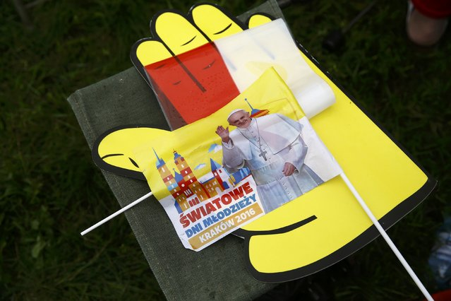 """A flag with Pope Francis picture is seen before the farewell ceremony at Balice airport near Krakow, Poland July 31, 2016. Sign in Polish reads """"World Youth Day"""". (Photo by Kacper Pempel/Reuters)"""