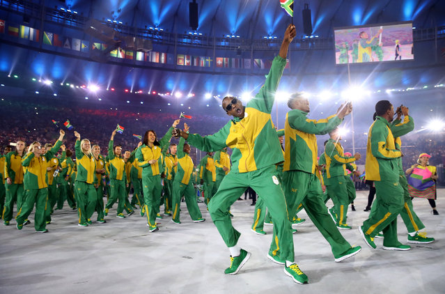 Members of the South Africa team take part in the Opening Ceremony of the Rio 2016 Olympic Games at Maracana Stadium on August 5, 2016 in Rio de Janeiro, Brazil. (Photo by Cameron Spencer/Getty Images)