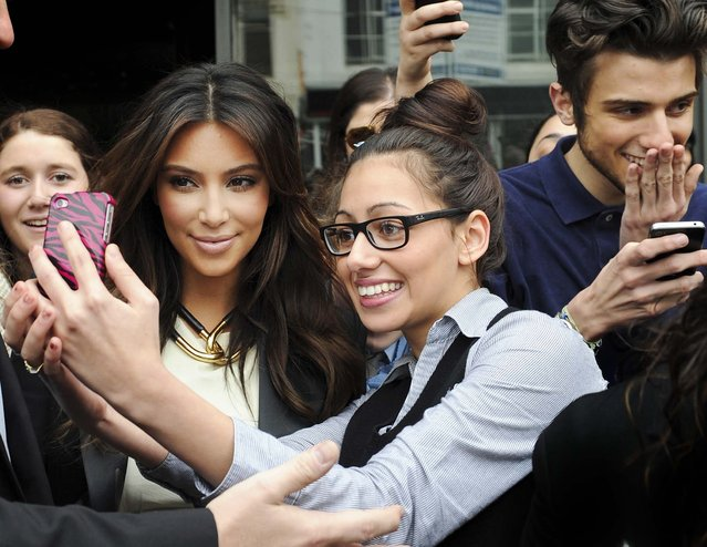 Kim Kardashian, is surrounded by fans as she leaves a radio station in Melbourne, Australia, on September 21, 2012. (Photo by Mal Fairclough/Associated Press)