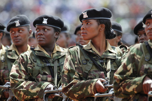 Kenya women army soldiers during march past at the Nyayo National Stadium, in Nairobi, on June 1, 2012, during the 49th Madaraka Day celebrations, which marks the independence from British rule. (Photo by Sayyid Azim/AP Photo)