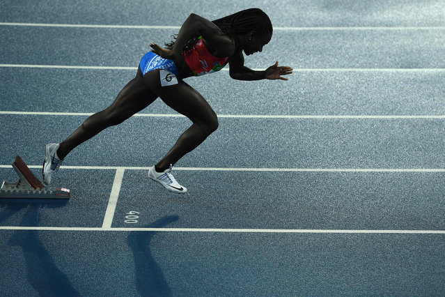 Puerto Rico's Grace Claxton competes in the Women's 400m Hurdles Round 1 during the athletics event at the Rio 2016 Olympic Games at the Olympic Stadium in Rio de Janeiro on August 15, 2016. (Photo by Jewel Samad/AFP Photo)