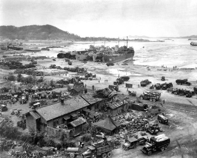 Invasion of Ichon, Korea.  Four LST's unload men and equipment on beach. Three of the LST's shown are LST-611, LST-745, and LST-715. September 15, 1950. (Photo by  C.K. Rose, Navy)