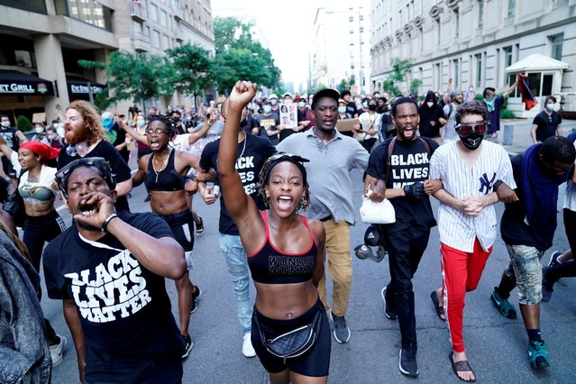 Demonstrators march towards the White House during racial inequality protests in downtown Washington, U.S., June 23, 2020. (Photo by Erin Scott/Reuters)