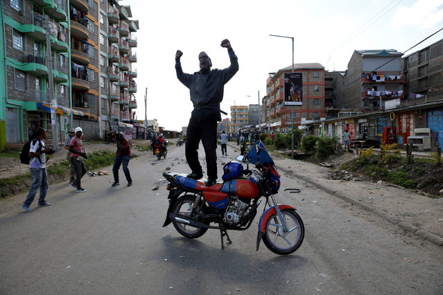 A supporter of Kenyan opposition National Super Alliance (NASA) gestures as he stands atop a motorbike in Nairobi, Kenya November 28, 2017. (Photo by Baz Ratner/Reuters)